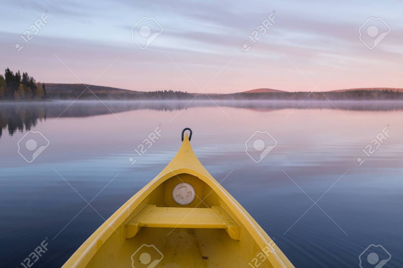 Kayaking on a quiet lake in Sweden during sunrise - 131595604