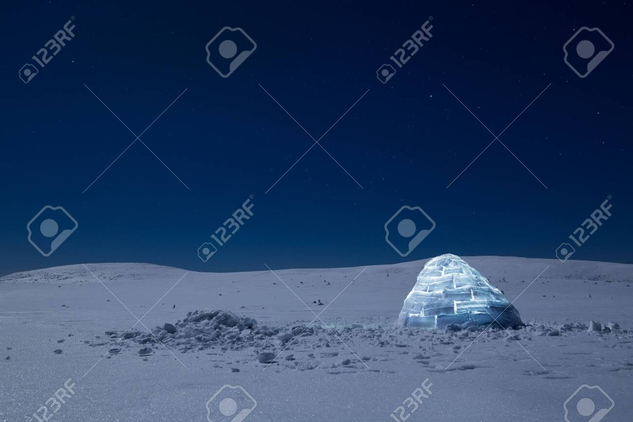 Iluminated igloo during a cold winter nights with bright moonshine - 131597889
