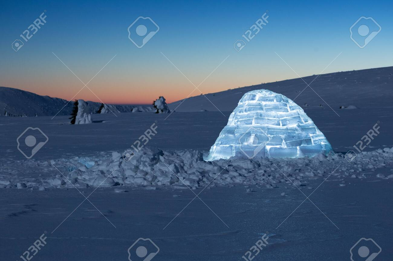 Iluminated igloo during a cold winter nights with bright moonshine - 131607526