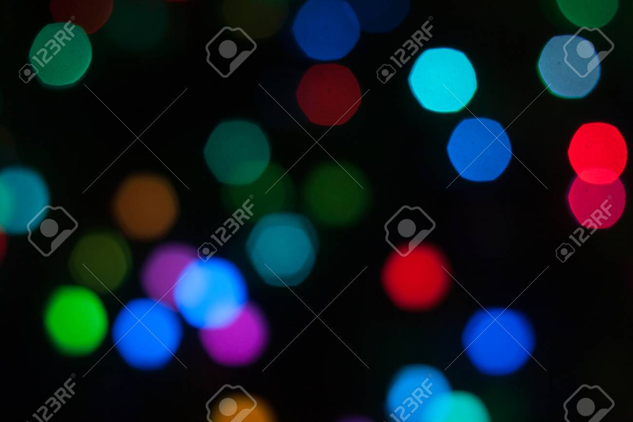 abstract background of out of focus lights at night light hexagon