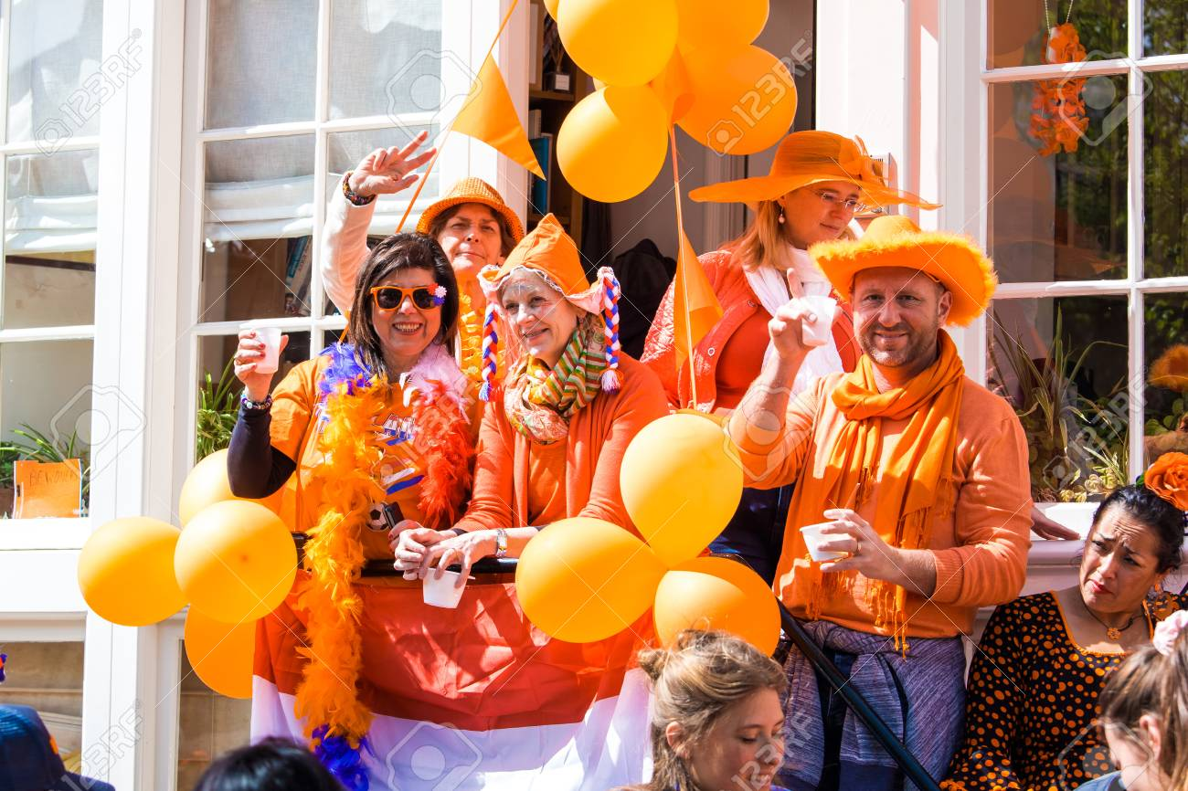 Amsterdam, Netherlands - April, 2018: People on the street celebrate Kings day in Amsterdam city, Netherlands - 107475104