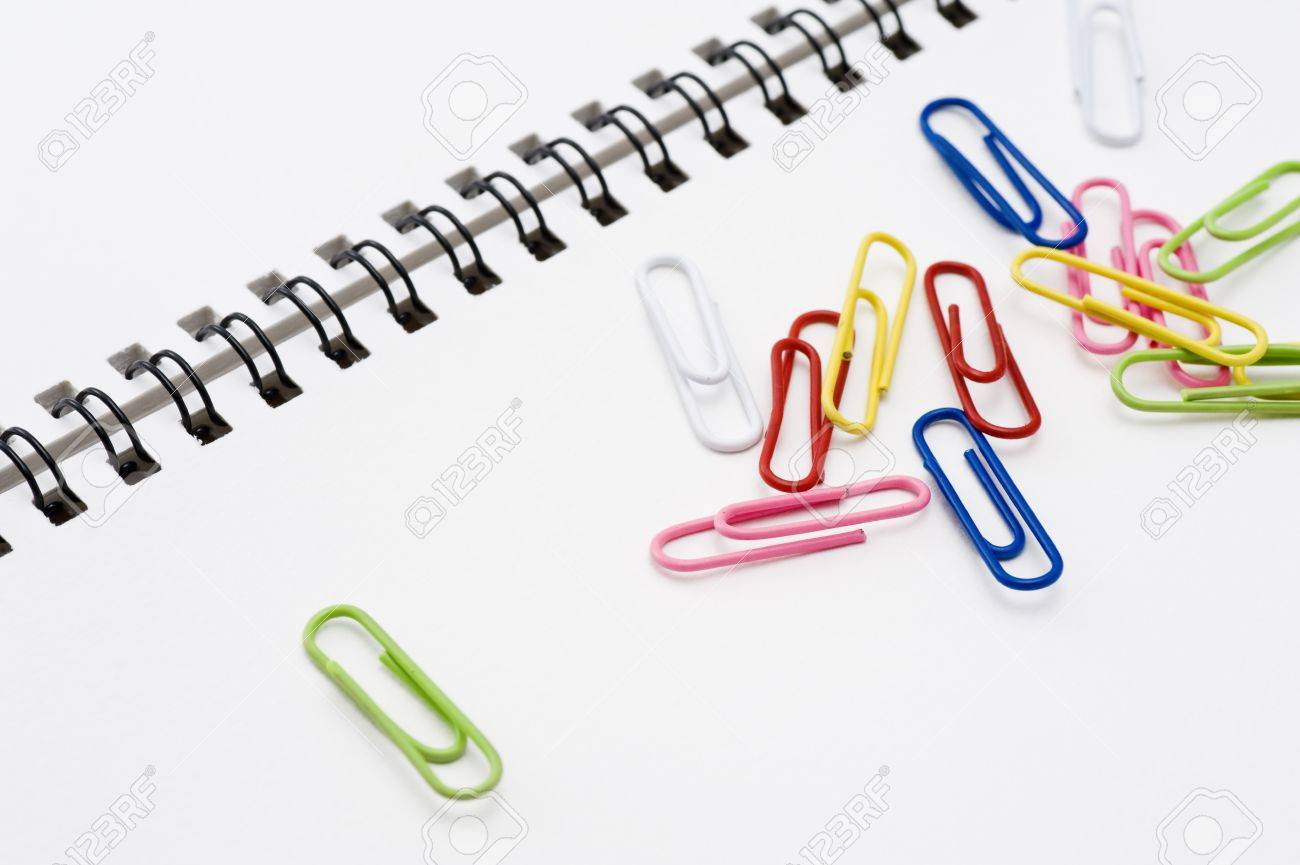 Colorful paper clip on white sketchbook, close-up Stock Photo - 16330627