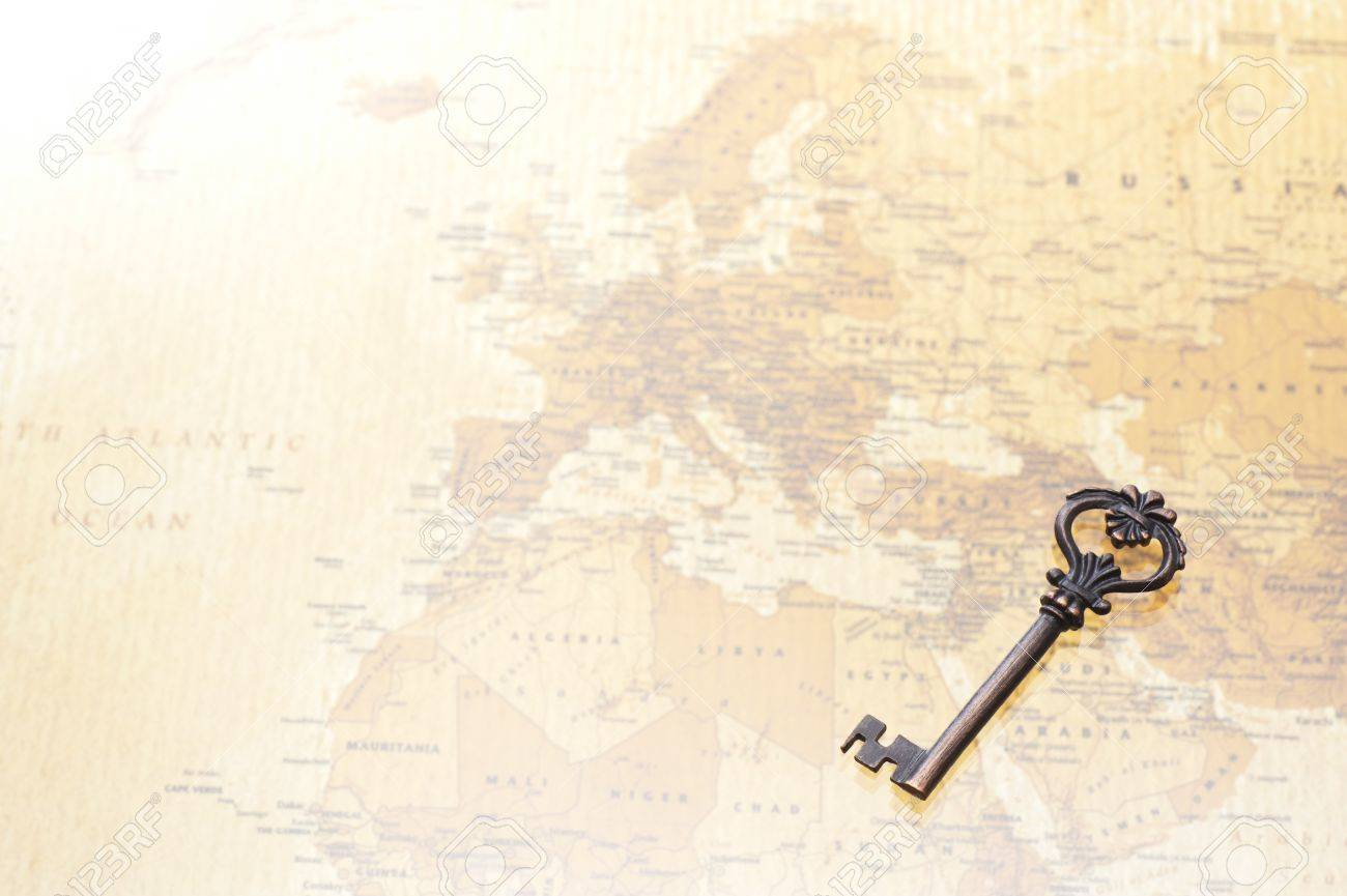 A Antique Key On World Map Background Stock Photo Picture And