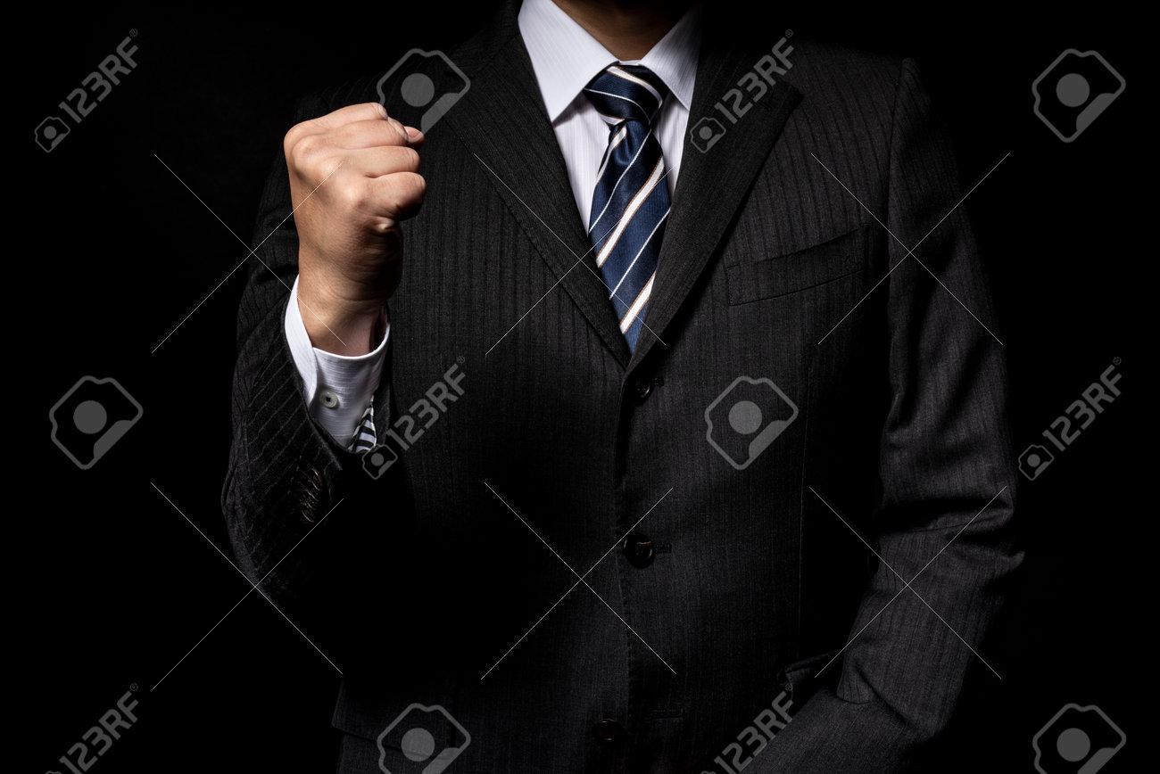 Presenting businessmen, black background - 169157356