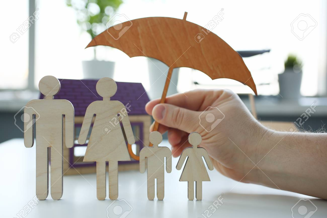 Male insurance agent hold hands gesture shield - 115867907