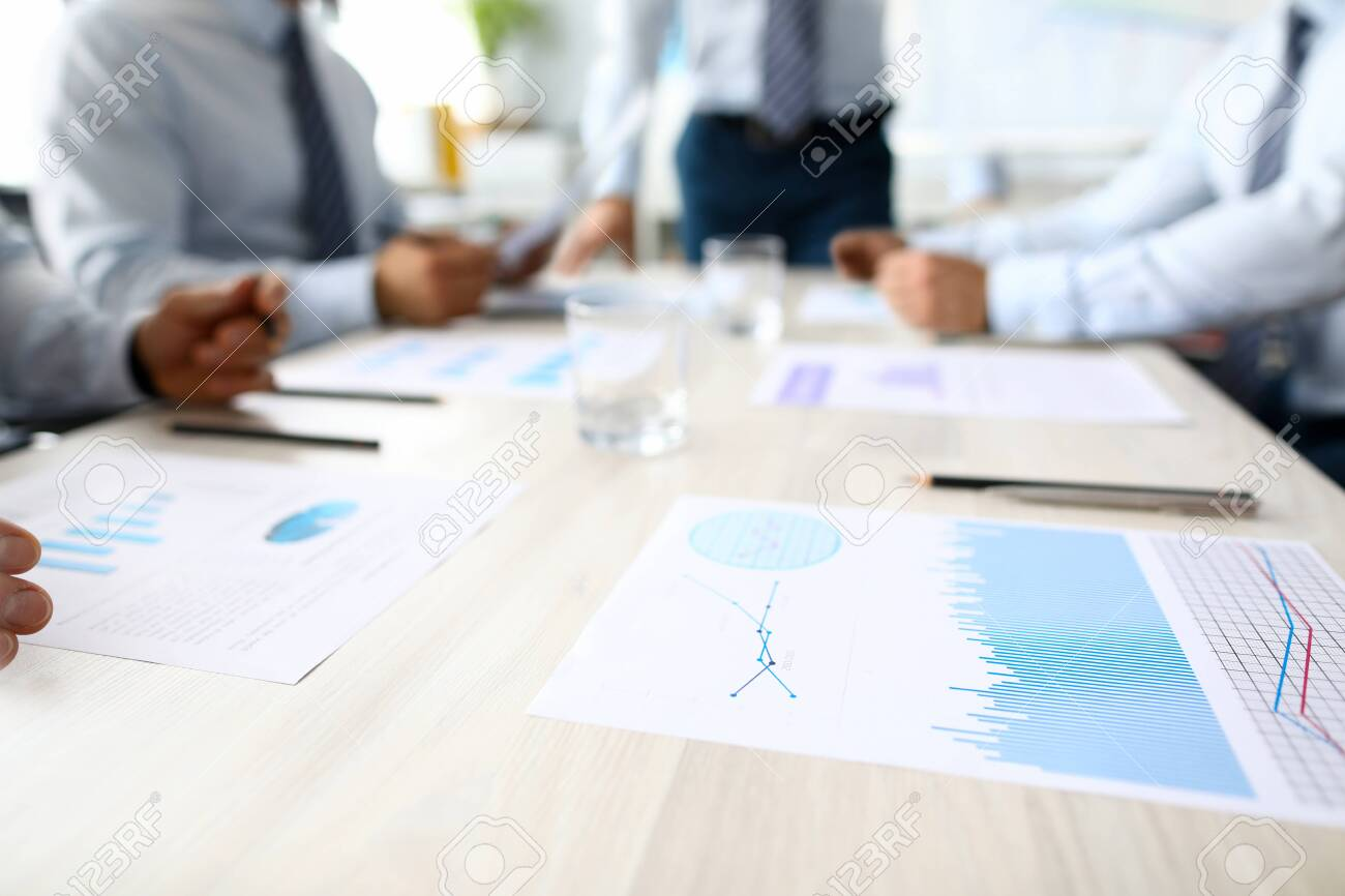 Business chart lie on table against group people office background. Seminar financial statistic analisys concept. Class room education lesson - 129199722