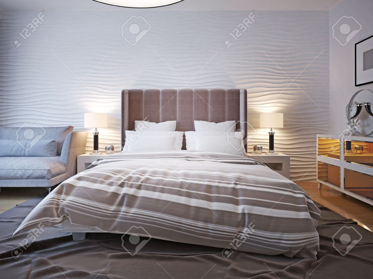 Unmade bed with large headboard two bedside table with lamps stock photo unmade bed with large headboard two bedside table with lamps on both sides of the bed with a large headboard the wavy wall behind and a big mozeypictures