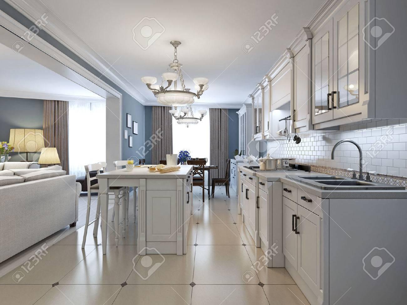 Küche Mit Küchengeräten Aus Edelstahl, Weiße Schränke, Weiße Ziegel ...