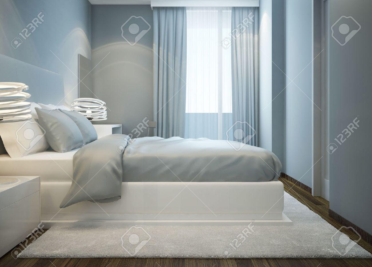 cama blanca nevado en la habitación azul. dormitorio principal con