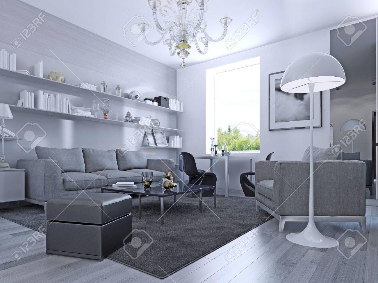 Séjour dans un style moderne. salon élégant avec des murs blancs et sol  stratifié gris clair. système de mur avec des étagères blanches.