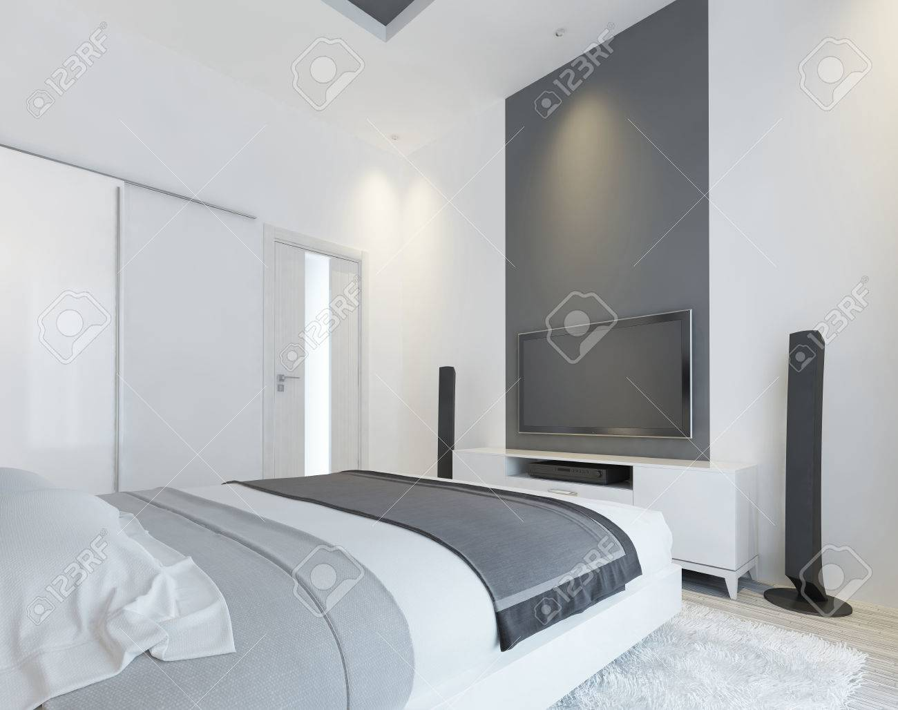 . TV console with speakers in the modern bedroom in white and gray