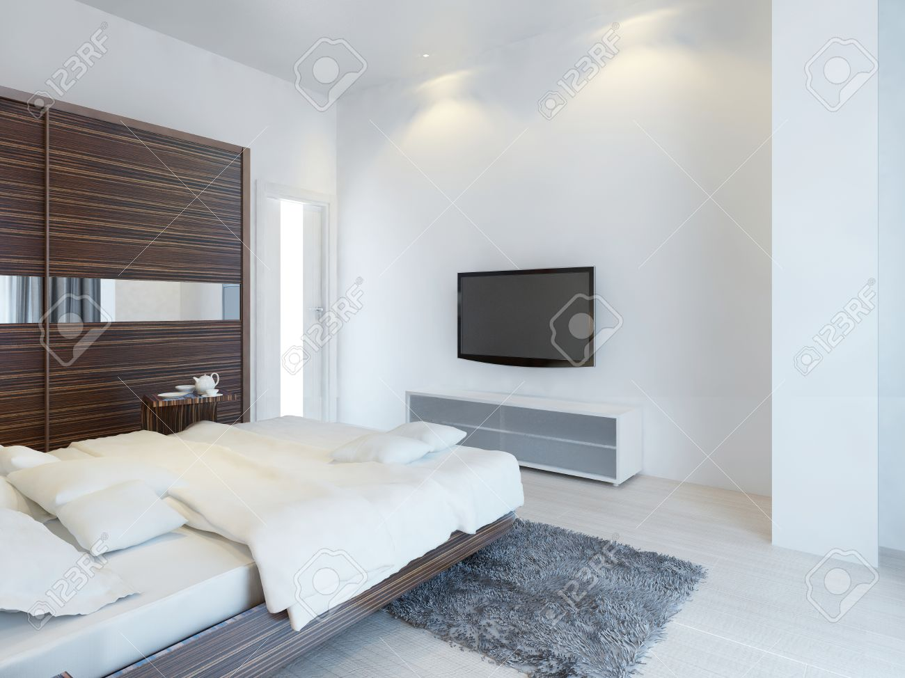 . Bedroom with TV and a media console with a large sliding wardrobe