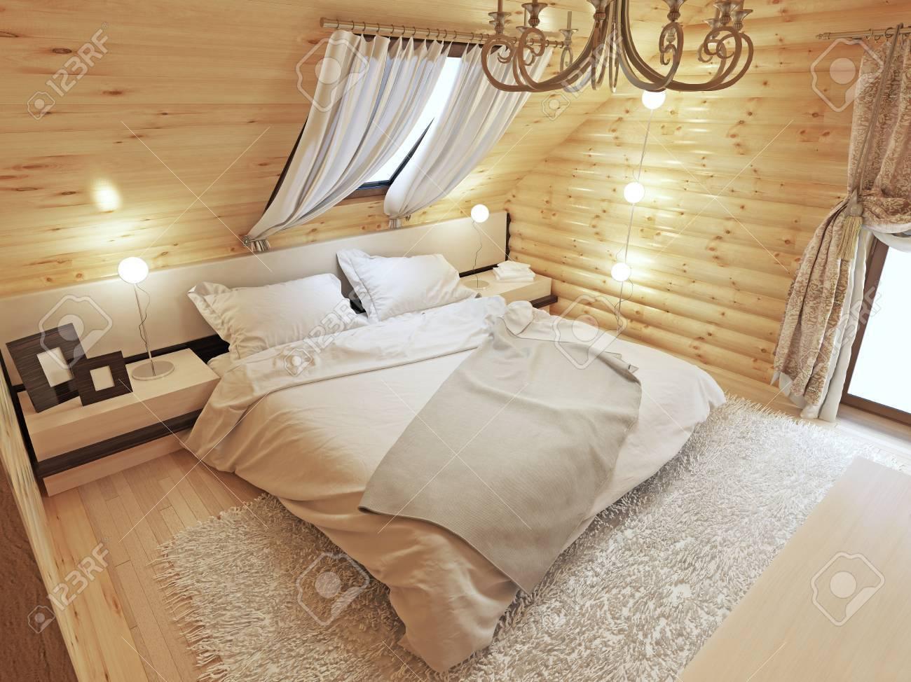 Aménagement Grenier En Chambre Autorisation intérieur de la chambre à coucher dans un rondin au grenier avec une  fenêtre de toit. grande chambre avec tables de chevet et un tapis shaggy.  chambre