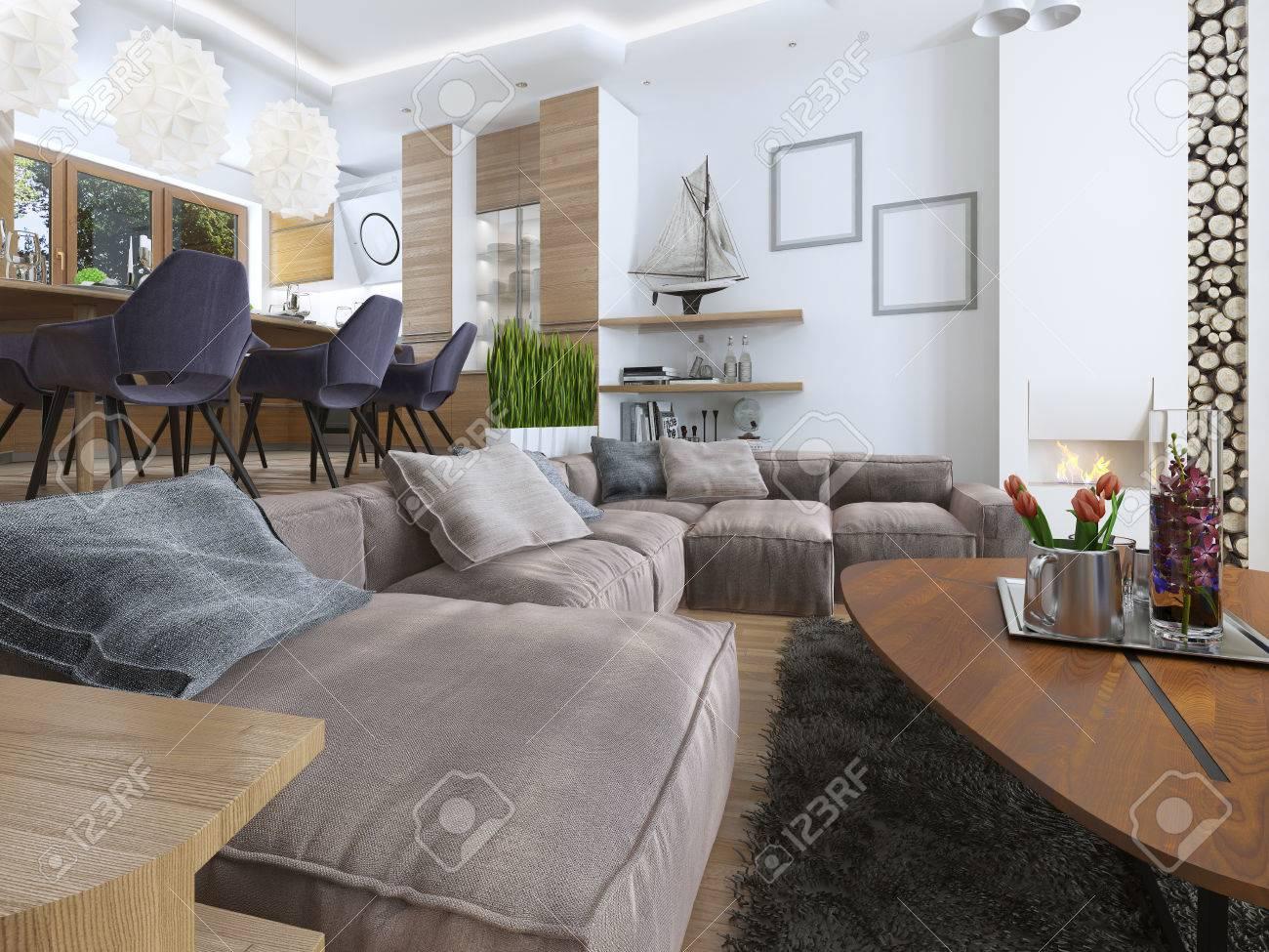 Moderna sala de estar con un estilo loft, mezclando suavemente en la cocina  comedor. Gran sofá esquina, estantes con decoraciones, silla suave con una  ...
