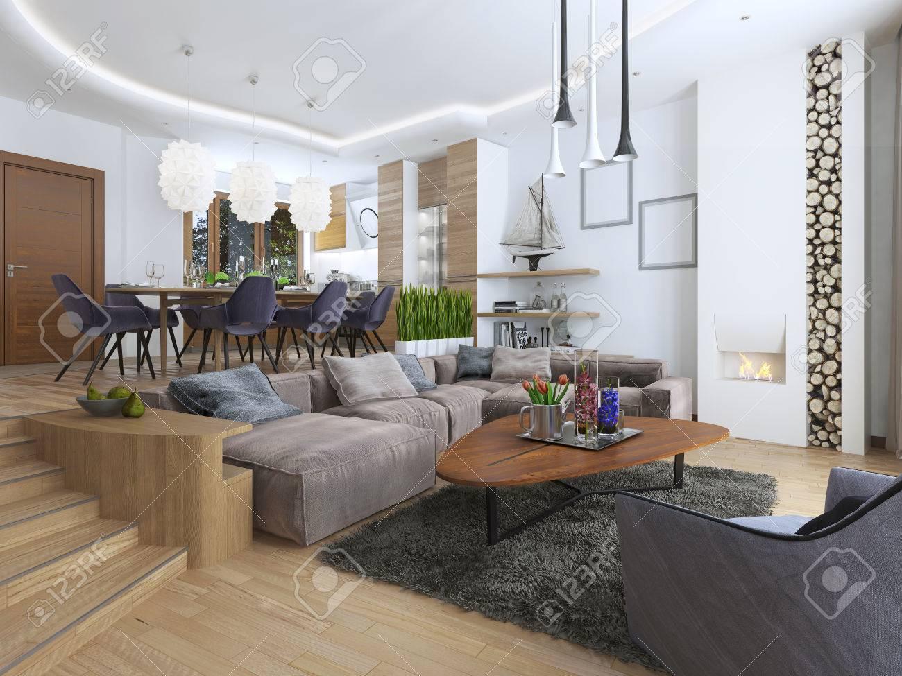Salon moderne dans un style loft, mélangeant harmonieusement dans la cuisine salle à manger. Grand canapé d'angle, des étagères avec des décorations,