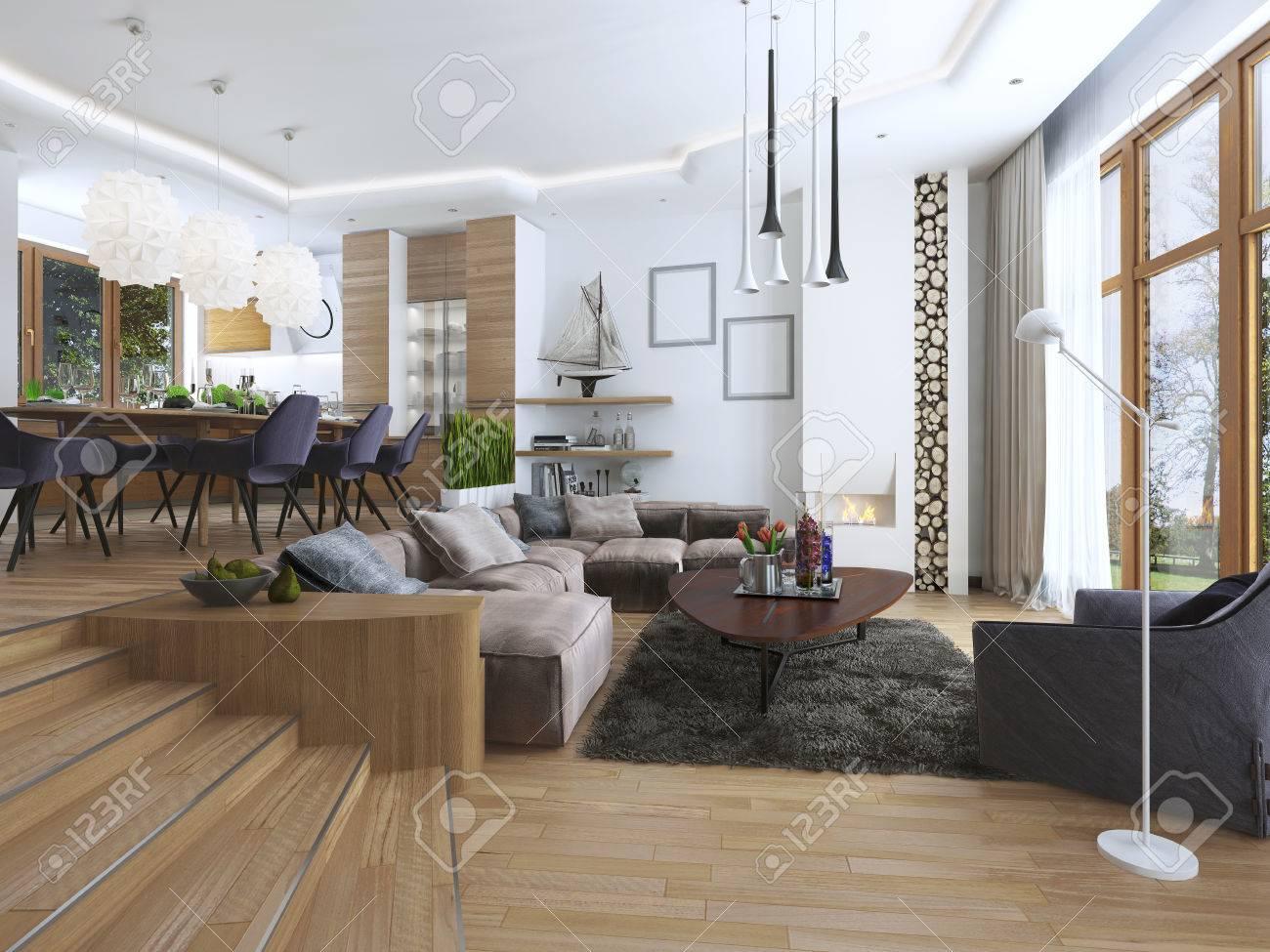 Das Zimmer Ist Ein Studio Mit Küche Und Essbereich Sowie Ein Wohnzimmer Auf  Der Unteren Ebene