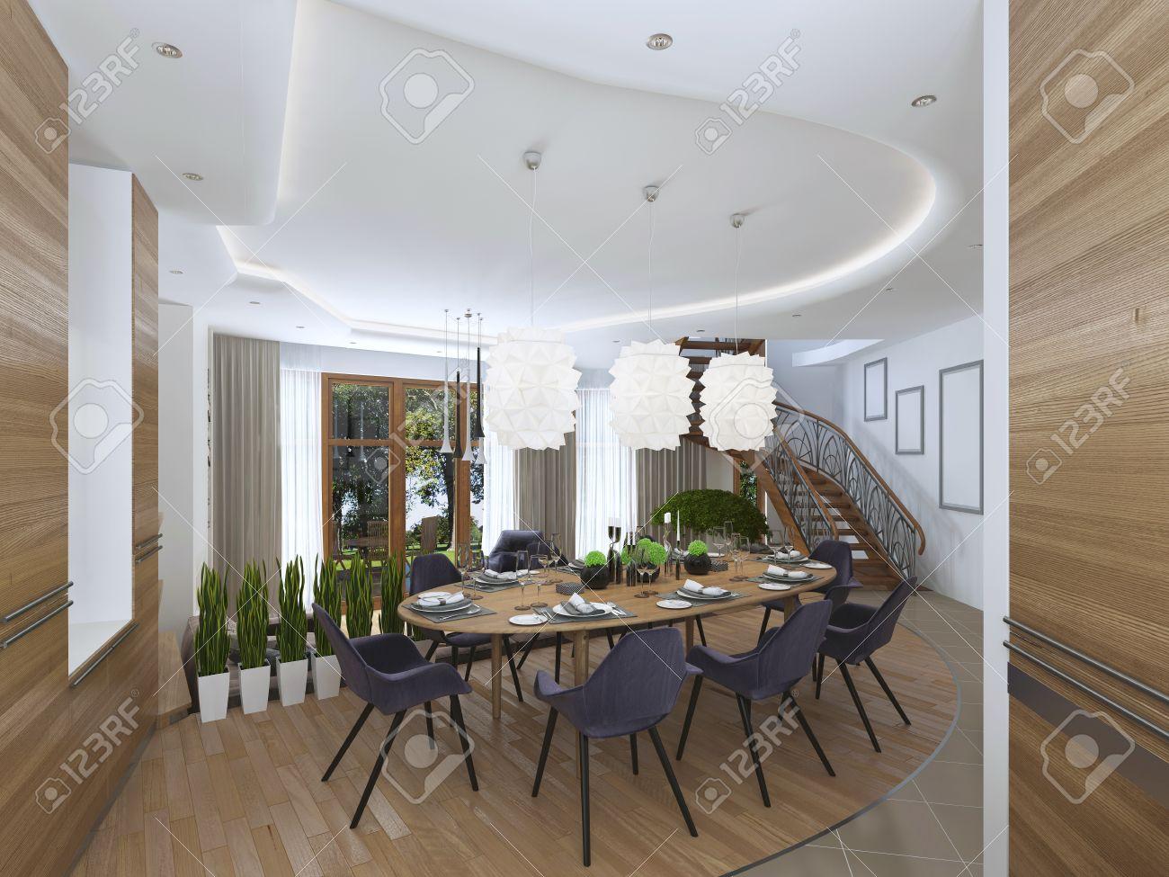 Der Große Esstisch In Der Küche Mit Acht Gepolsterten Stühlen Und ...