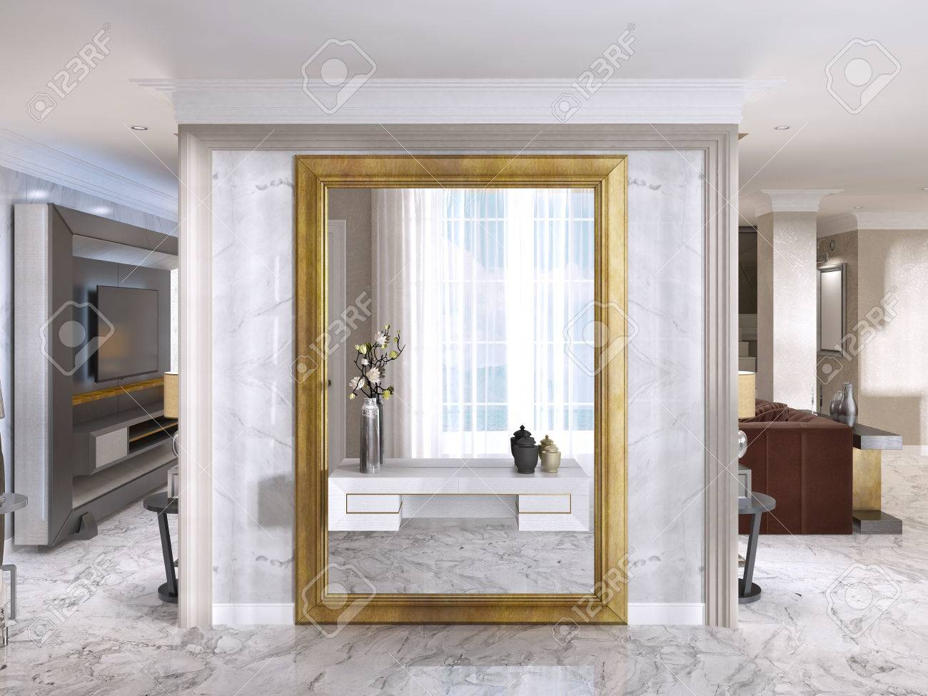 Luxurious art deco entrance hall with a large designer mirror in gold frame and built