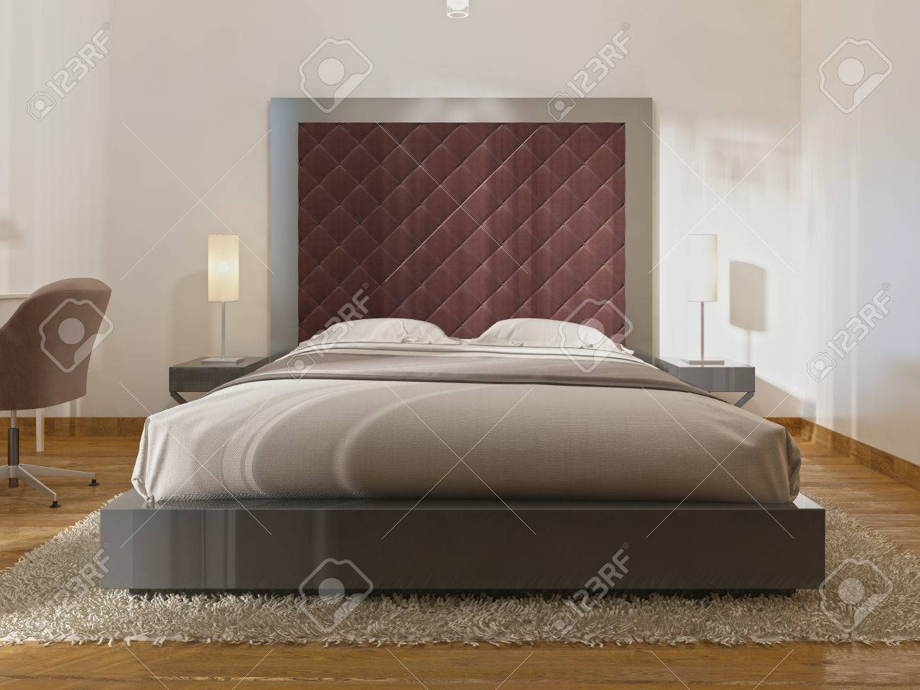 Luxurious One Double Bed In The Hotel Room In Art Deco. A Large Padded  Headboard