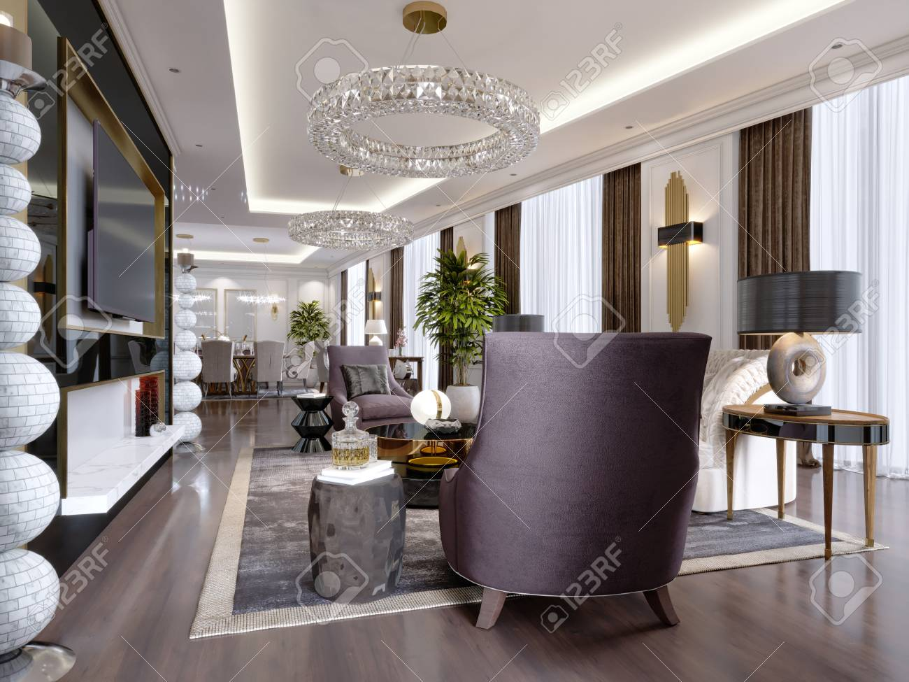 A modern classic style hotel room with a lounge and dining area and designer