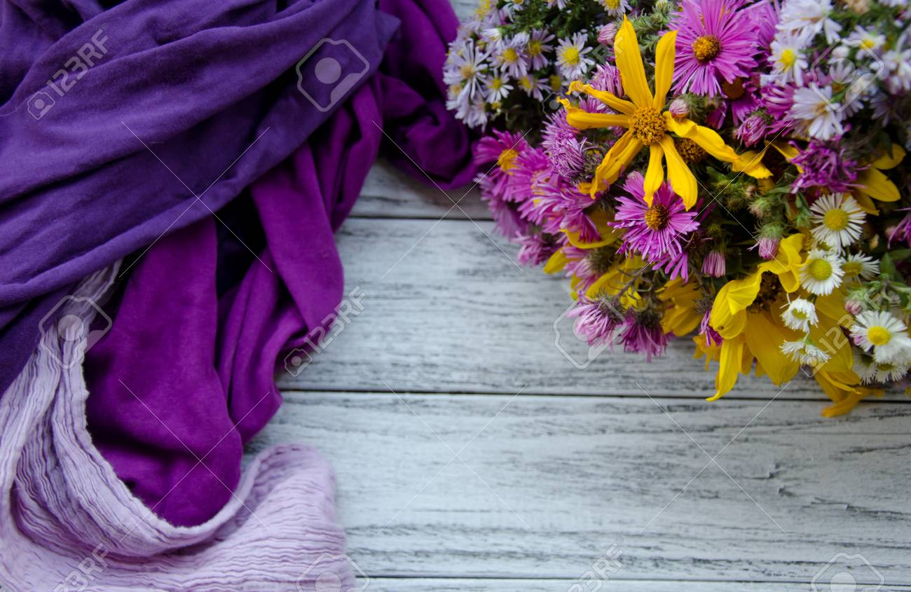 Bouquet Of Bright Autumn Flowers And Pile Of Scarves Forming Stock Photo Picture And Royalty Free Image Image 87403961