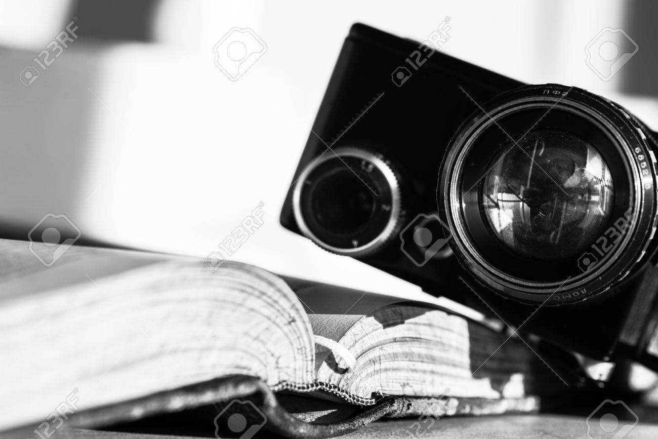 Open book and an ancient video camera black and white photo stock photo 40299785