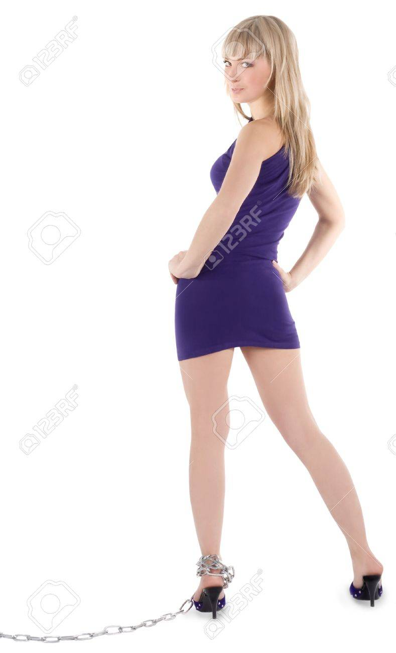 Sexy blonde in purple dress on high heel shoes in chains Stock Photo - 7017439