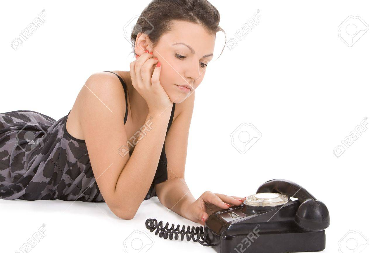 young woman looking at old phone waiting for a call Stock Photo - 7108402