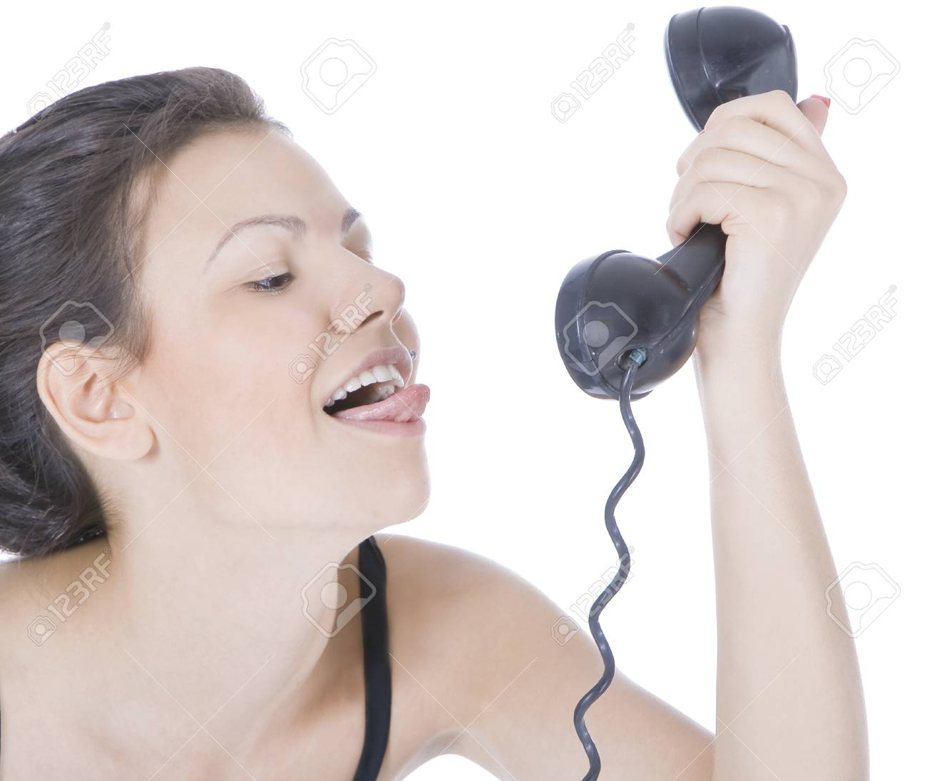 Bright picture of fun brunette showing tongue to phone Stock Photo - 8601404