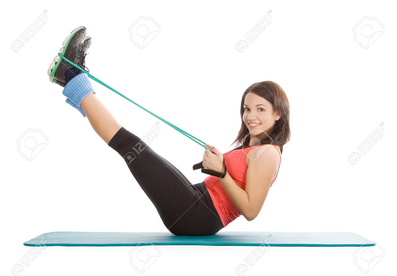 Attractive young female with fitness expander in stretching Stock Photo - 9225714
