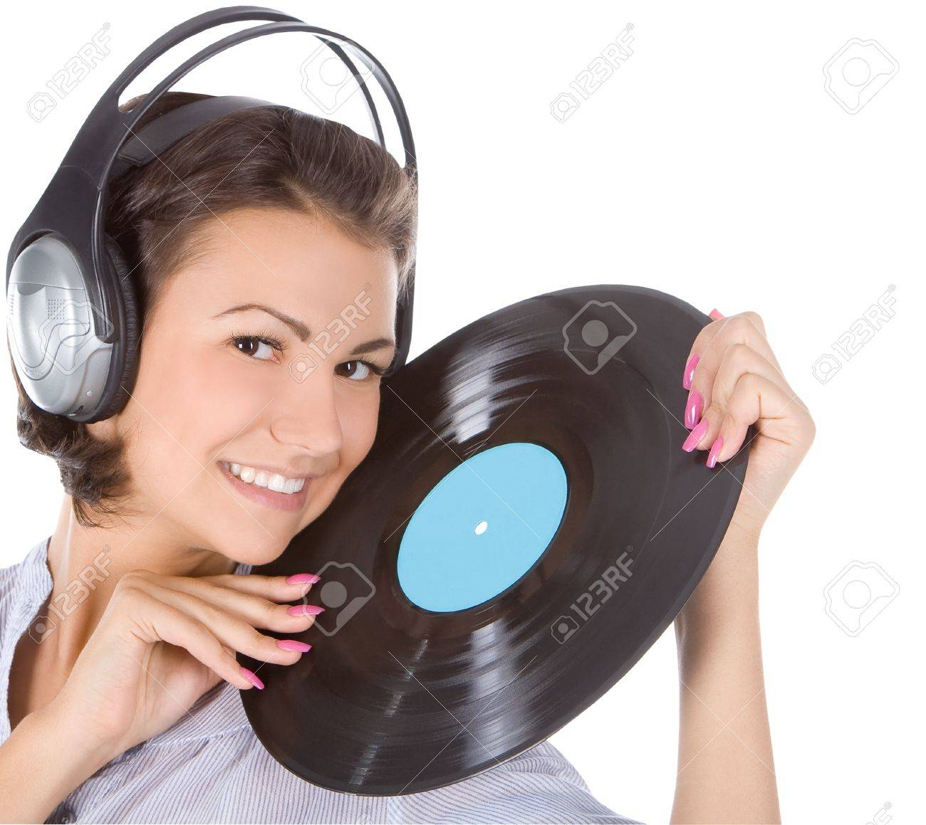 emotional brunette in headphones with vinyl record over white Stock Photo - 9260905