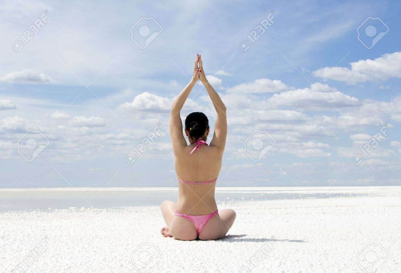 Beautiful young woman doing yoga exercise outdoors Stock Photo - 10072569