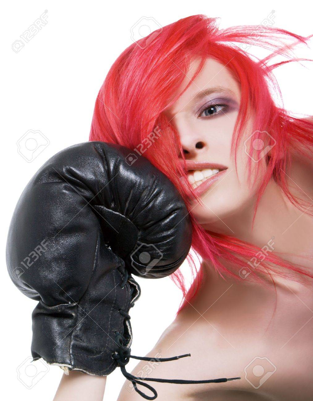 Red-hair girl receives a knockout blow in the face of boxing gloves Stock Photo - 10072586