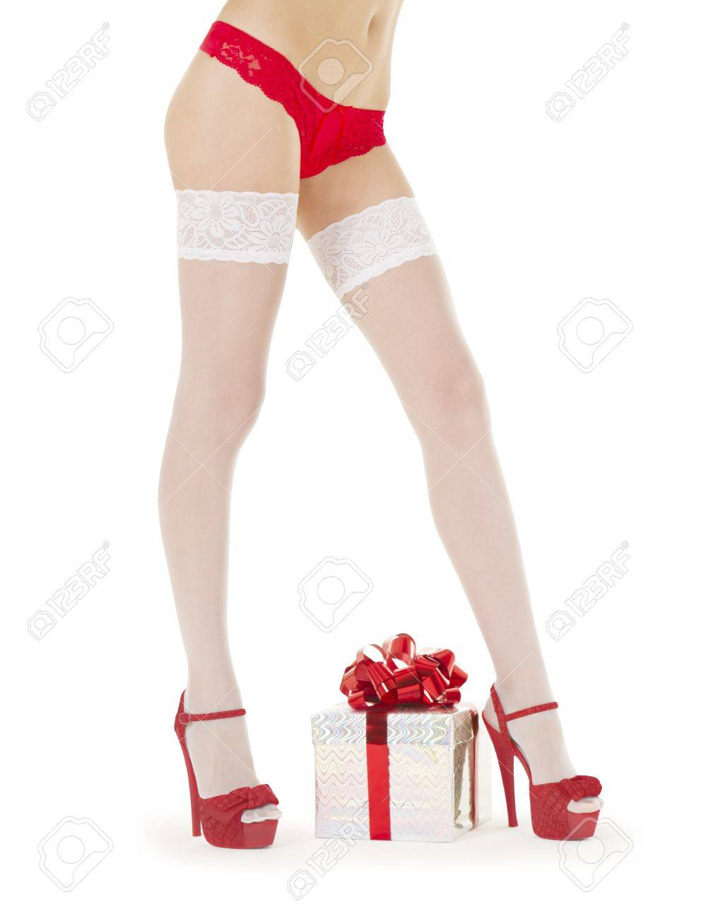 sexy female legs in white stockings with Christmas gift Stock Photo - 10103255