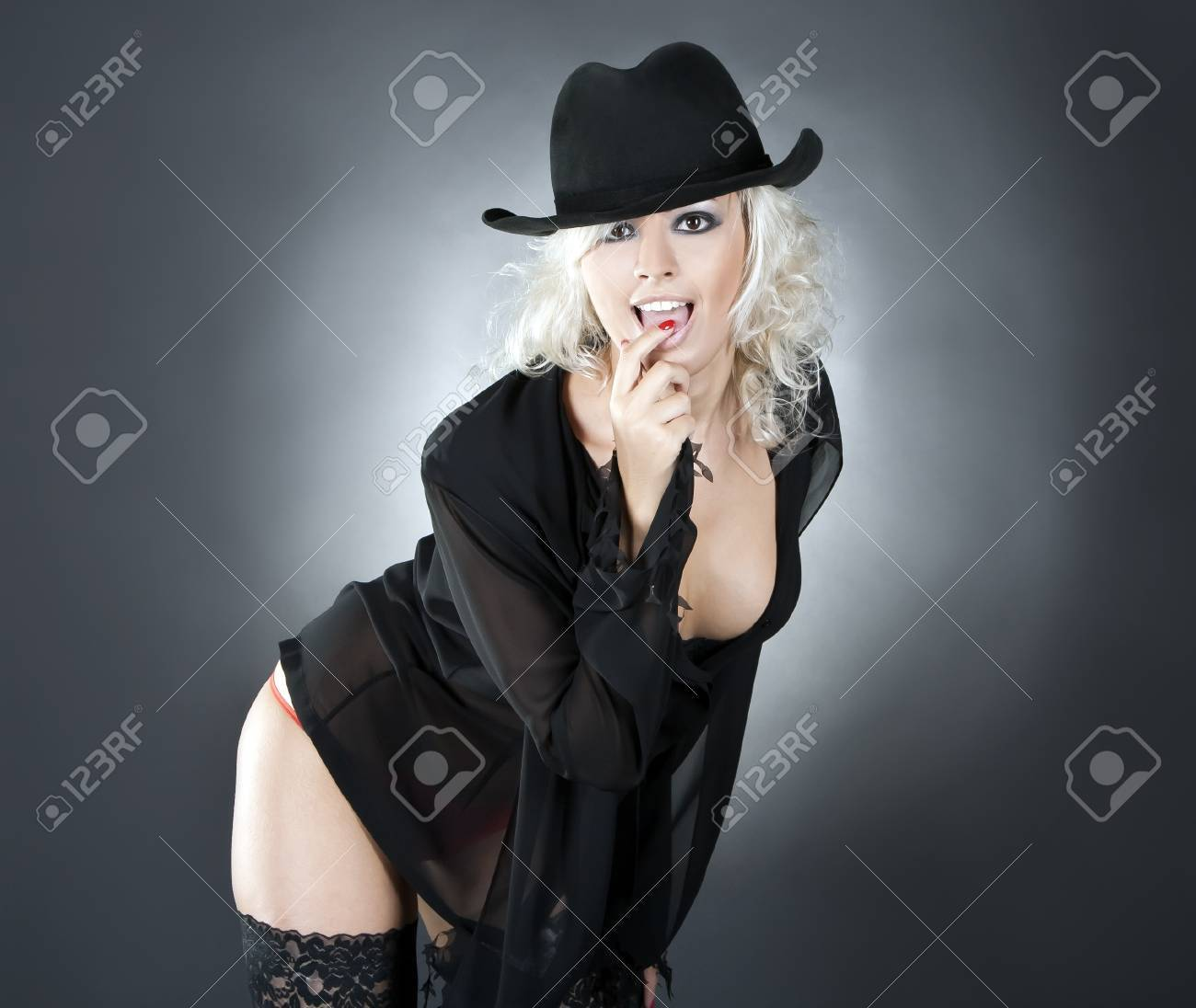blonde fashion woman portrait wearing black hat over dark Stock Photo - 10197505