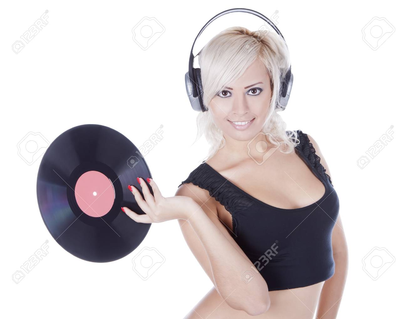 emotional blonde in headphones with vinyl record over white Stock Photo - 10197471