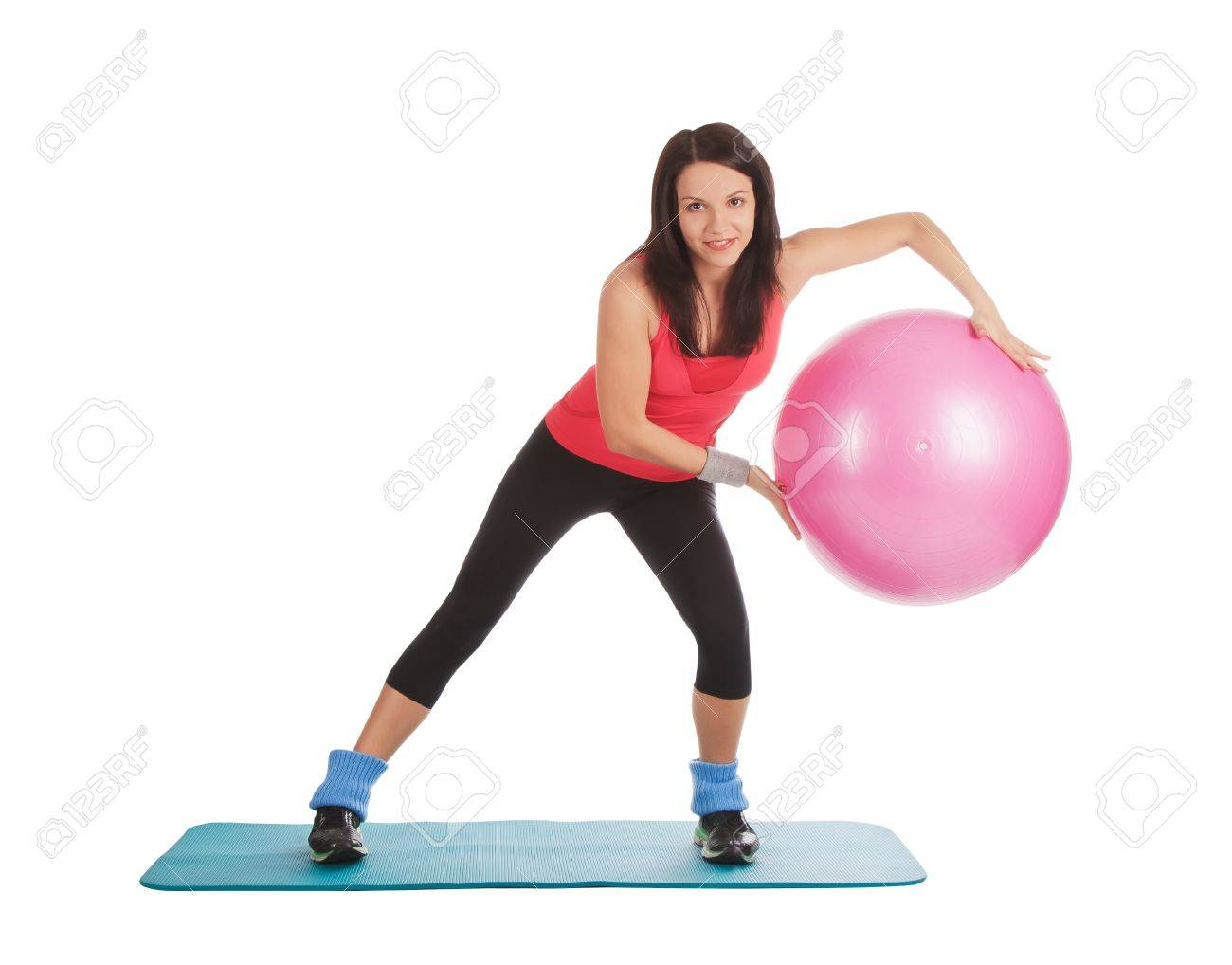 Attractive young female with fitness ball in stretching Stock Photo - 13645856