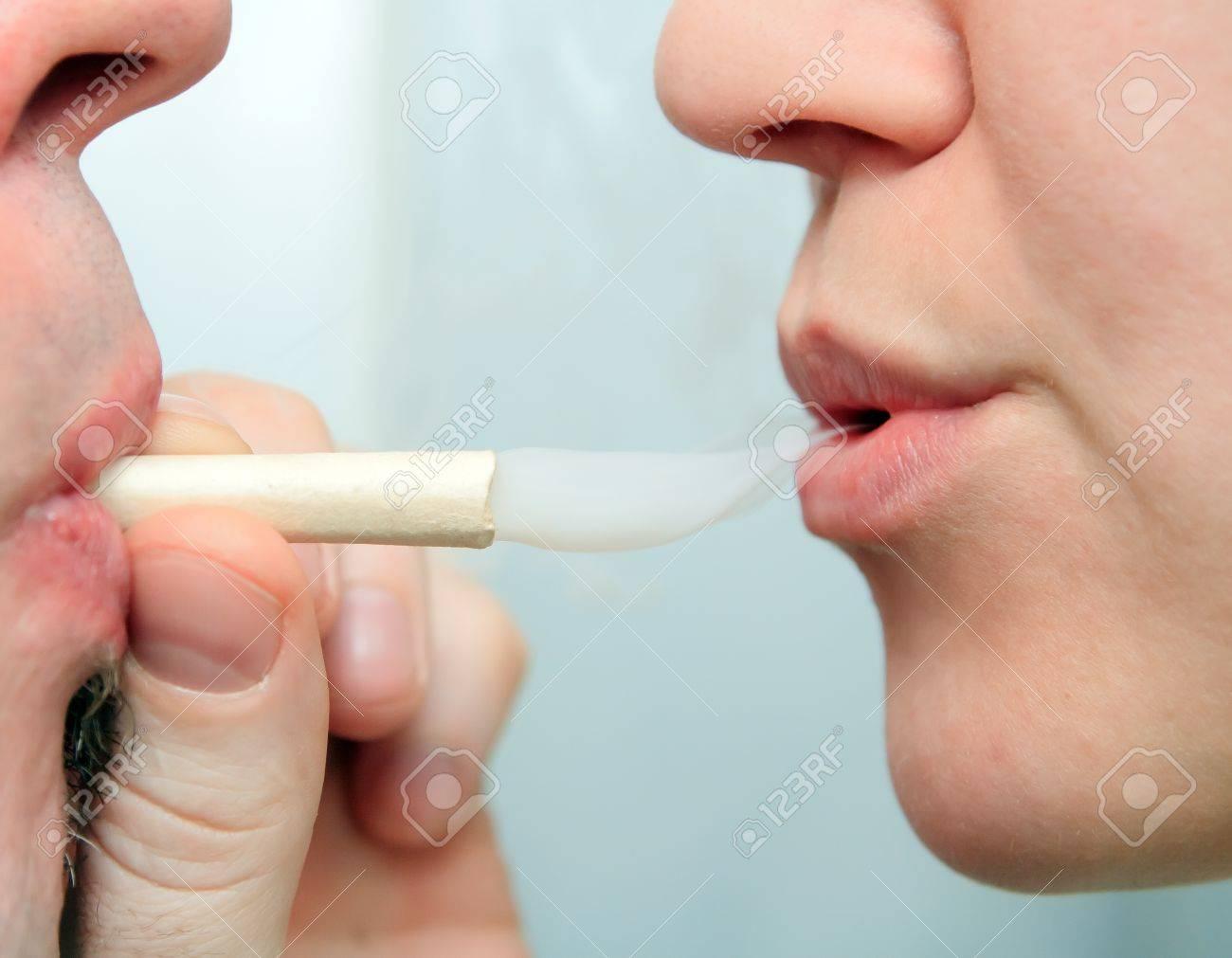 people enjoying smoking marijuana joint closeup Stock Photo - 14302337