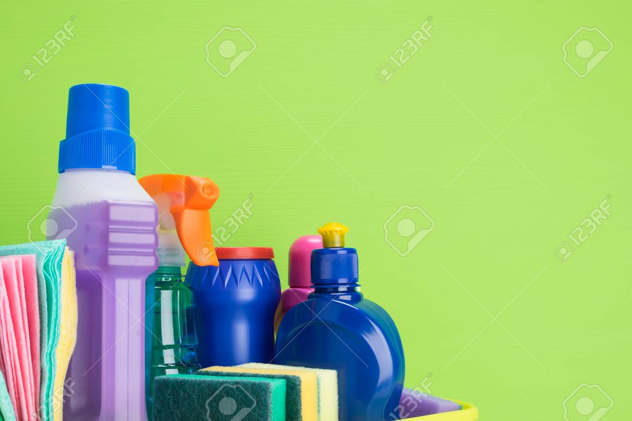 set of liquid and powder products and items for cleaning indoors on a green background, a place for an inscription - 116857089