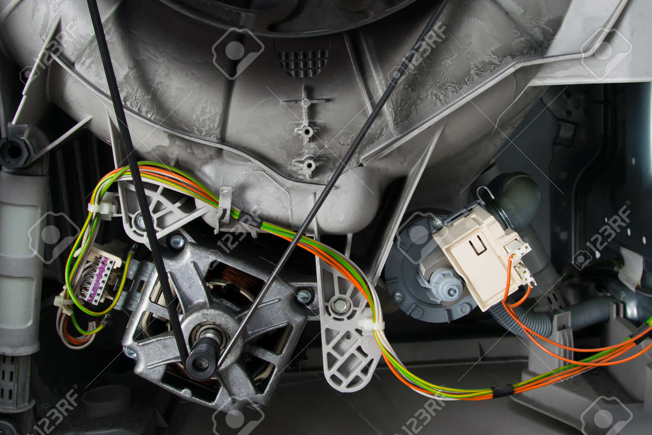 close-up of the internal structure of the washing machine, the engine and electrical wiring with the contact group - 169656864