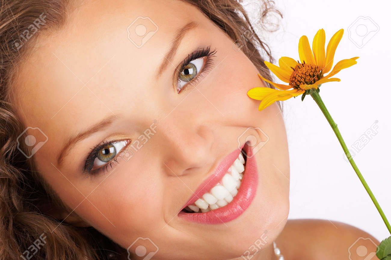 Pretty smiling woman with fresh  flower Stock Photo - 556617
