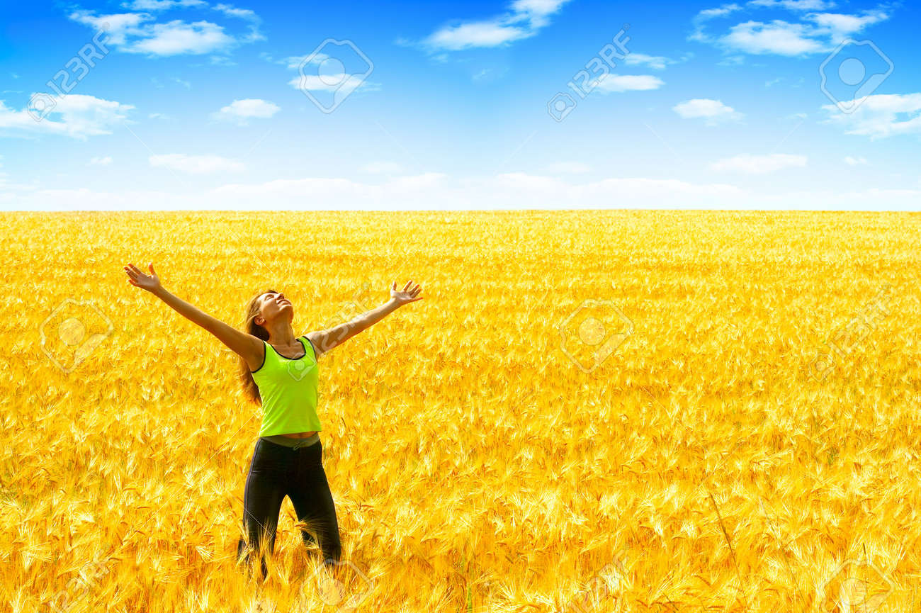 Happy young woman in the field Stock Photo - 2770132