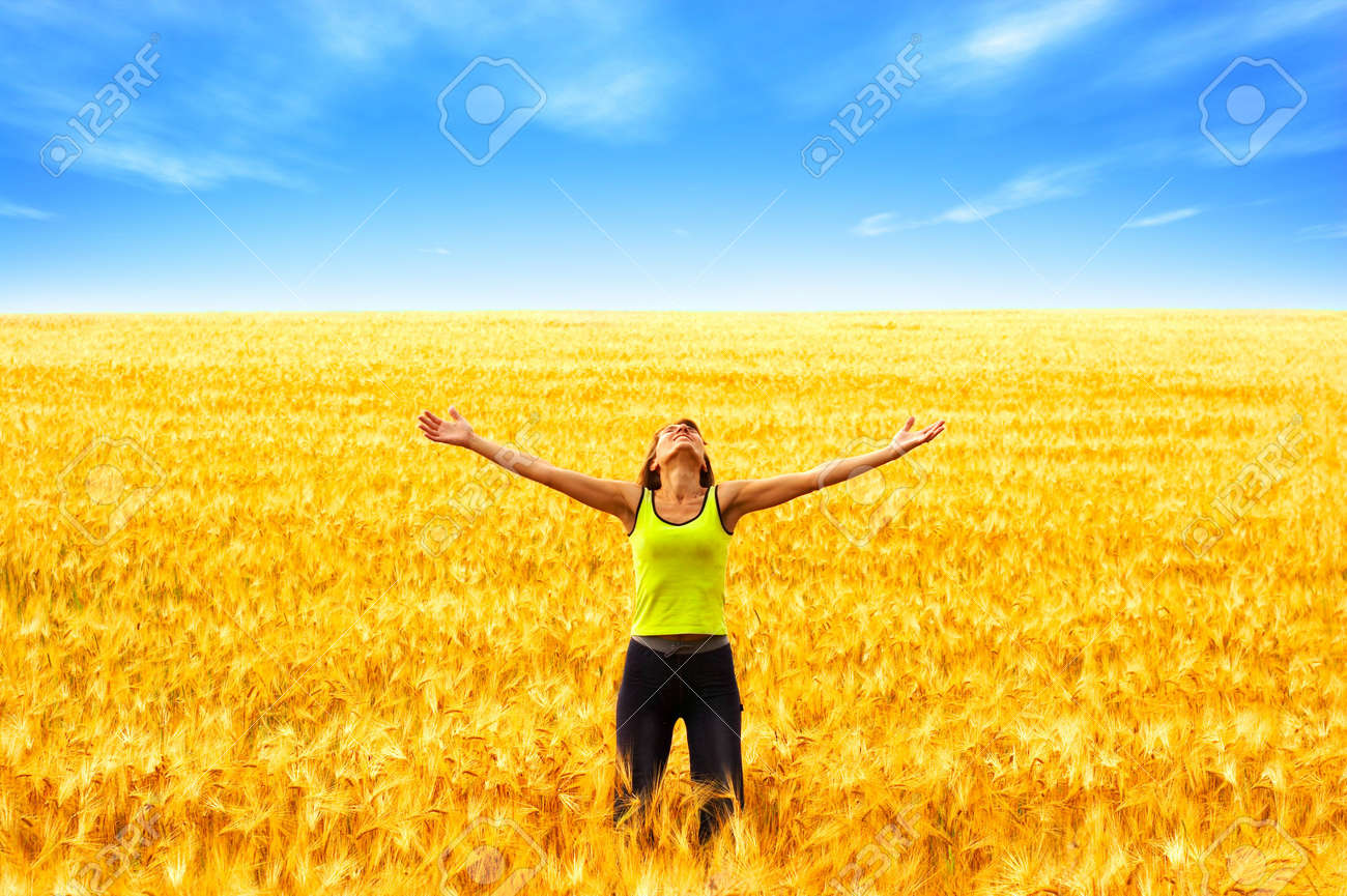 Happy young woman in the field Stock Photo - 1999308