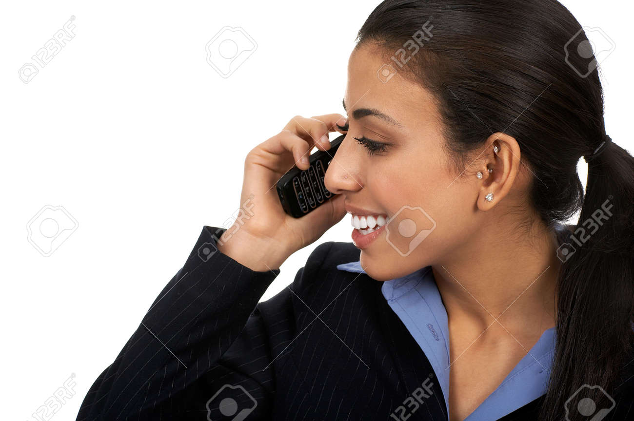 Eastern business young woman calling by cellular phone. Stock Photo - 2405658