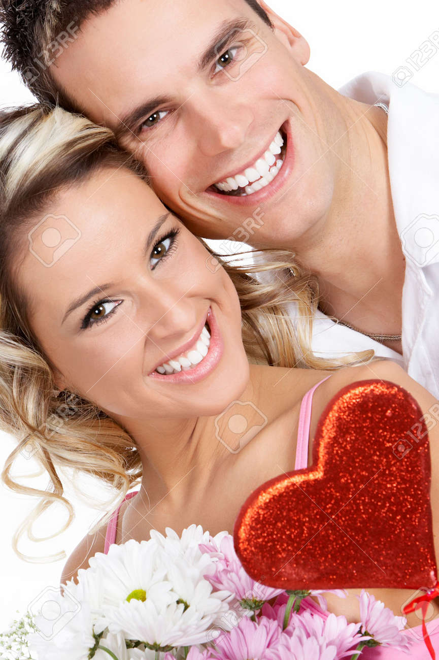 Young love couple smiling. Over white background Stock Photo - 2505705