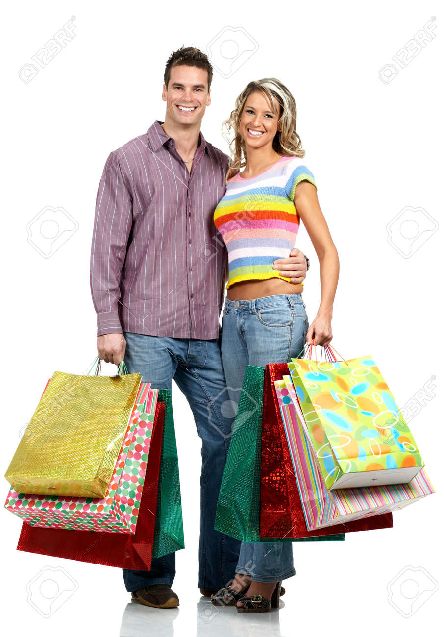 Shopping  couple  smiling. Isolated over white background Stock Photo - 2505751