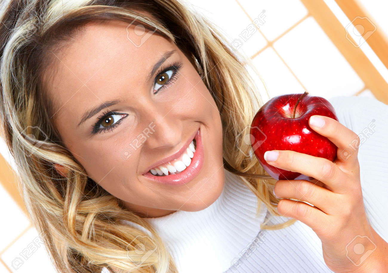 Beautiful young woman eating the red apple. Stock Photo - 2505738