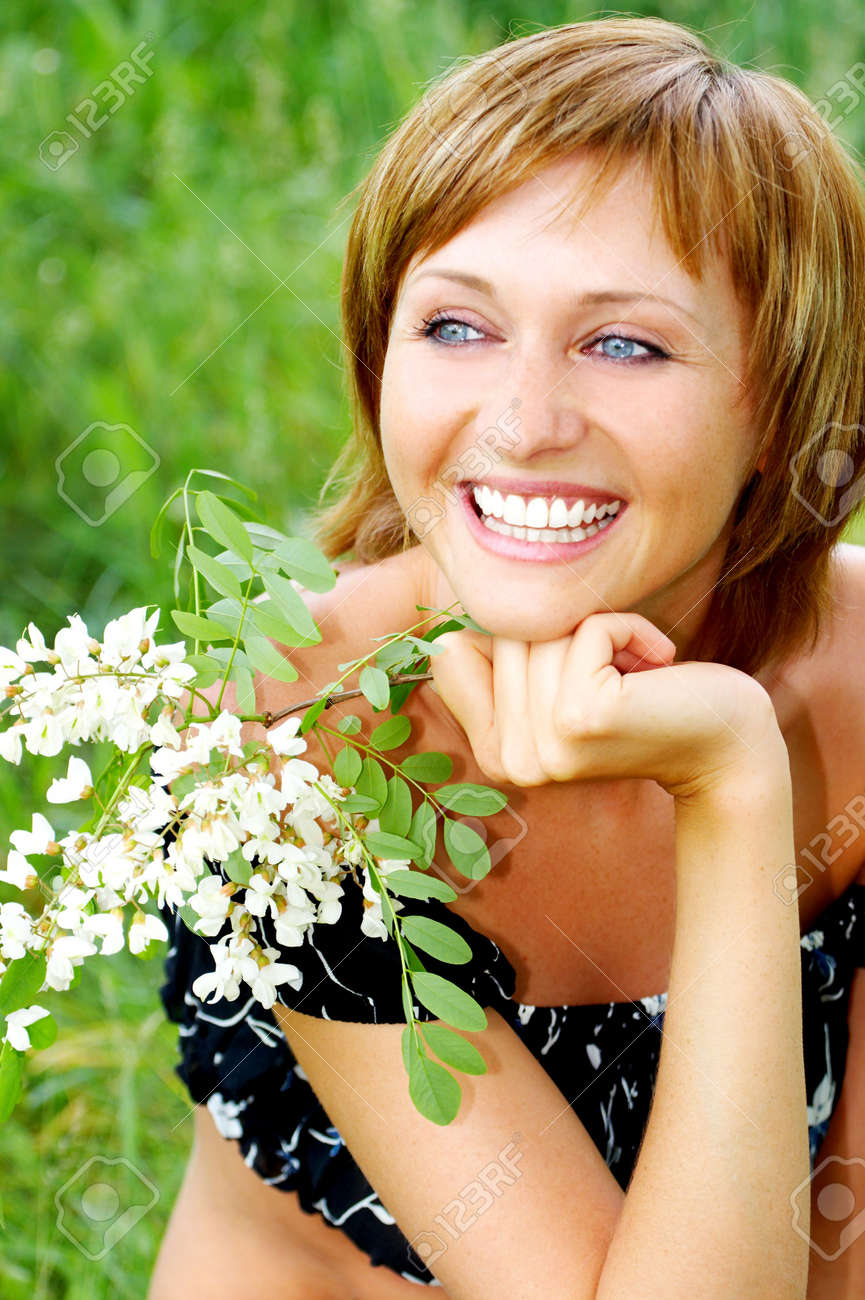 Young happy beautiful smiling woman with flower stock photo picture stock photo young happy beautiful smiling woman with flower izmirmasajfo