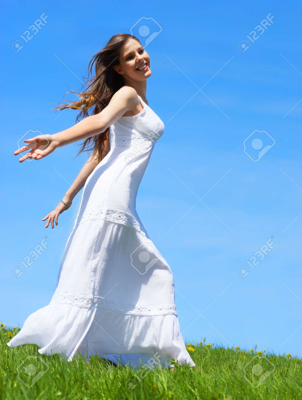Happy young woman running  in the field Stock Photo - 3048968