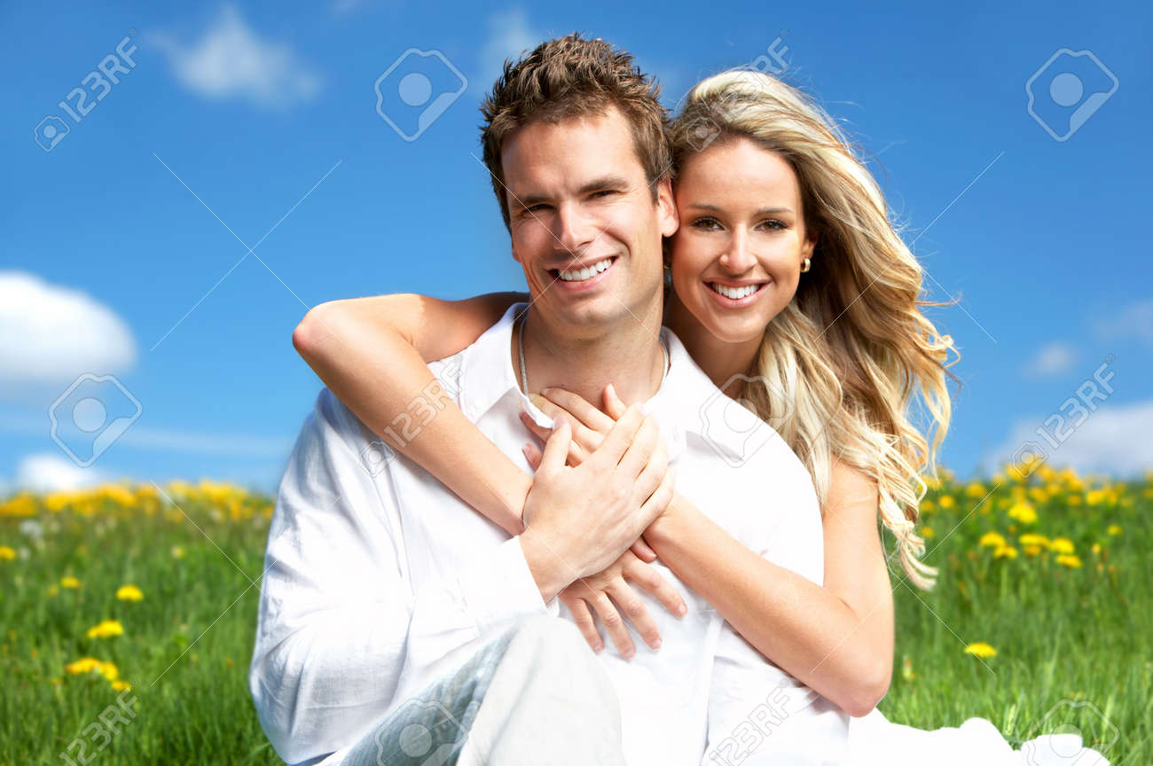 Young love couple smiling under blue sky Stock Photo - 3076355